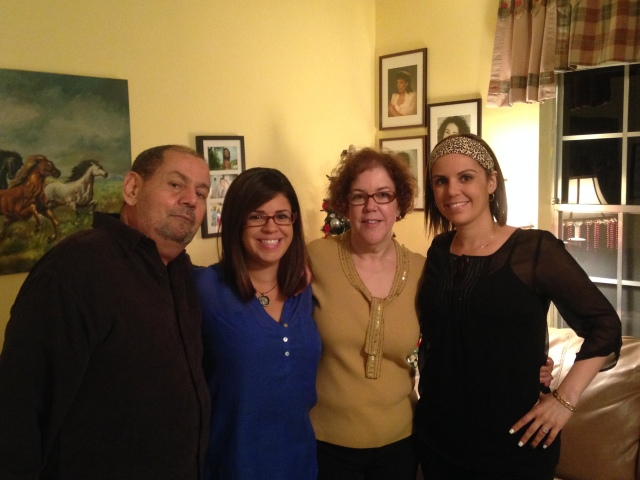 My parents, sister and I on Christmas Eve.